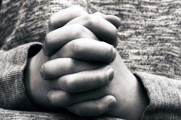 Child praying hands